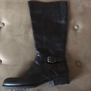 Franco Sarto Black high boots with metal clasp.
